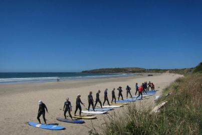 surf school catlins Mission WOW Curio Bay Tomo